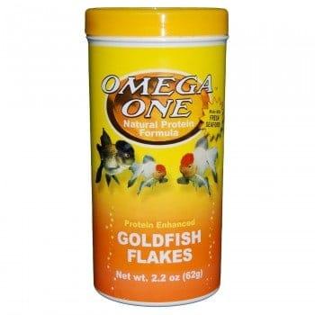 Pot of Omega one goldfish flakes on white background