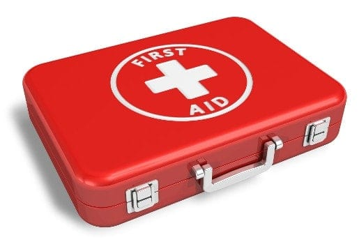 A red case style first aid kit isolated on white