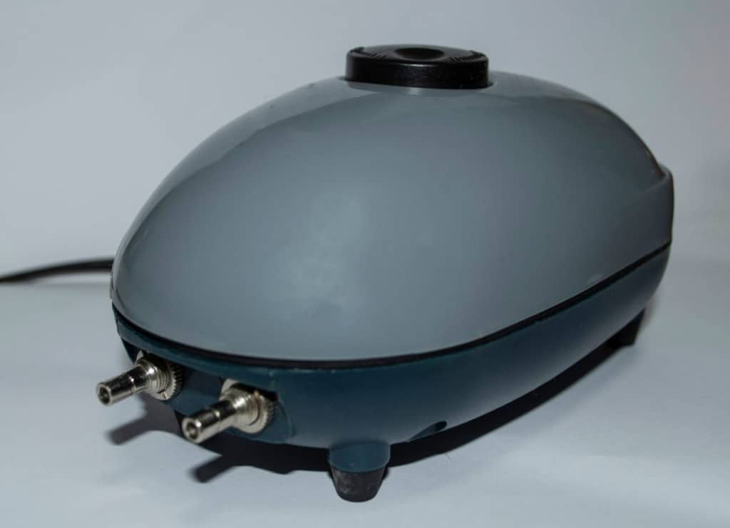 Close up of an isolated, grey air pump with two air outlets