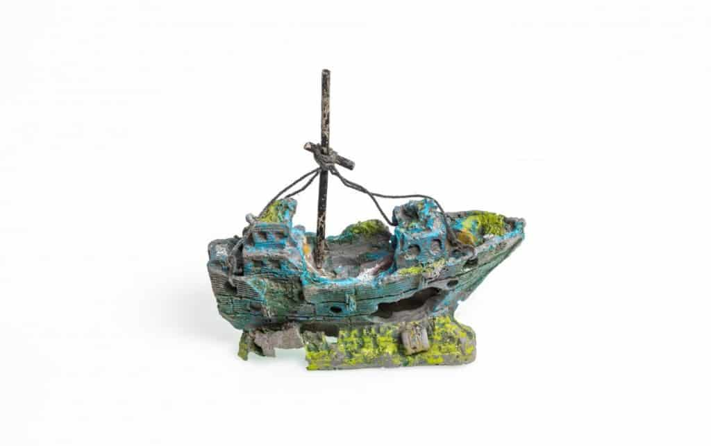 A pirate ship style aquarium ornament isolated on white